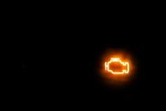 Mostra da luz de advertência do motor/emissões em um fundo Foto de Stock Royalty Free