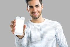 Mostra del qualcosa sul telefono Fotografia Stock
