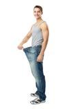 Mostra dell'uomo quanto peso ha perso Immagini Stock