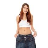Mostra della donna quanto peso ha perso.   Fotografia Stock Libera da Diritti