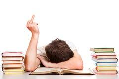 Mostra do estudante o dedo médio Imagem de Stock