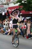 mostra do Unicycle da equitação para a parada alegre de Chicago Imagem de Stock