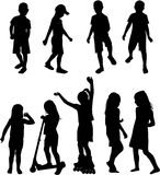 Mostra em silhueta crianças Fotografia de Stock Royalty Free