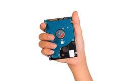Mostrando o disco rígido, mão que guarda o disco rígido Imagem de Stock