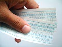 Mostrando Tickets.Isolated Imagens de Stock