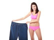 Mostrar da mulher quanto peso perdeu Imagem de Stock Royalty Free