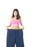 Mostrar da mulher quanto peso perdeu Fotos de Stock Royalty Free