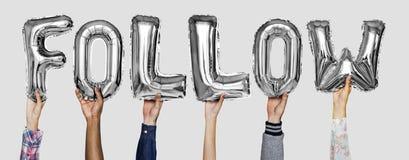 Mostrar das mãos segue a palavra dos balões para seguir foto de stock royalty free