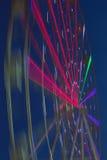 Mostrar do passeio do carnaval ferris de giro roda dentro a ação Imagem de Stock Royalty Free