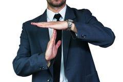 Mostras do homem de negócios que fazem o gesto da ruptura do tempo Foto de Stock