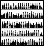 Mostre em silhueta frascos do álcool Imagem de Stock