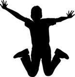 Mostre em silhueta o menino do salto Imagem de Stock