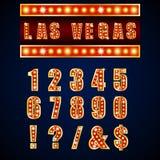 Mostre a lâmpadas alfabetos e números vermelhos no fundo azul Fotografia de Stock