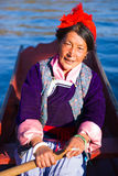 The Mosuo senior woman boating Royalty Free Stock Photography