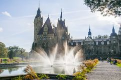 Moszna Castle, Silesia, Poland, October 2017. Moszna, Poland, October 2017. Façade of Moszna Castle with giant fountain in front royalty free stock photography