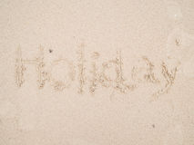 Mot écrit sur la plage image libre de droits