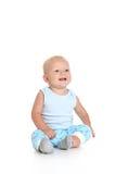 mot behandla som ett barn bakgrundspojken isolerad sittande white Royaltyfri Fotografi