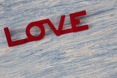 Mot bleu en bois de fond et d'amour Image stock