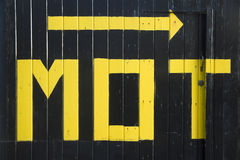 MOT. Bold hand painted sign outside motoring service garage Royalty Free Stock Photos