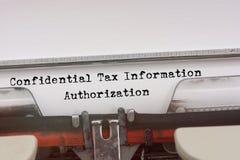 Mot confidentiel d'autorisation de renseignements fiscaux Images libres de droits
