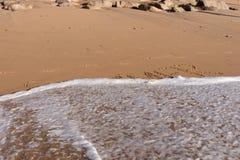 Mot d'été écrit dans la plage Photos libres de droits