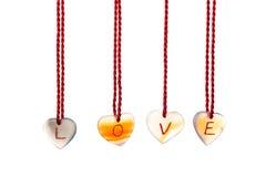 Mot d'amour écrit avec des agates Images libres de droits