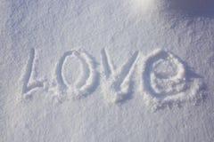 Mot d'amour écrit dans la neige Image libre de droits