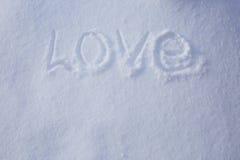 Mot d'amour écrit dans la neige Images stock
