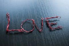 Mot d'amour créé utilisant le fil de fer Photos stock