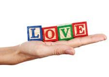 Mot d'amour dans une main Image stock
