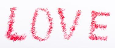 Mot d'amour dessiné par crayon avec la couleur rouge Images stock