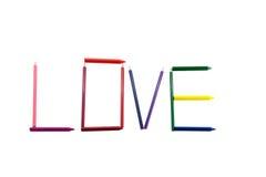 Mot d'amour par le crayon et le crayon Photographie stock libre de droits
