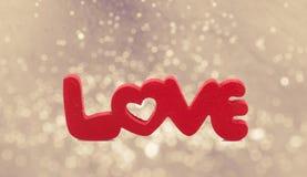 Mot d'amour sur le bokeh abstrait de tache floue Photo libre de droits