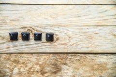 Mot d'amour sur le floor11 en bois Photographie stock