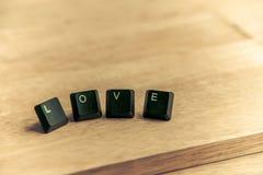 Mot d'amour sur le floor8 en bois Image stock