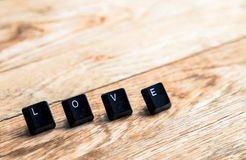Mot d'amour sur le floor3 en bois Images libres de droits