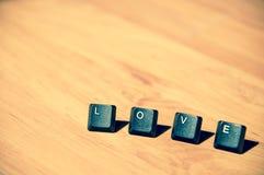 Mot d'amour sur le floor7 en stratifié Images libres de droits