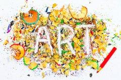 Mot d'ART sur le fond des copeaux de crayon Photo stock