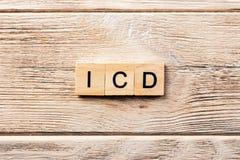 Mot d'Icd écrit sur le bloc en bois texte d'icd sur la table, concept photo libre de droits