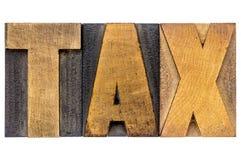 Mot d'impôts dans le type en bois Images libres de droits