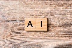 Mot d'intelligence artificielle écrit sur le bloc en bois Texte d'AI sur la table en bois pour votre desing, concept photos libres de droits
