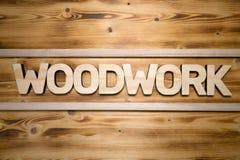 Mot de BOISAGE fait avec les blocs constitutifs sur le conseil en bois image libre de droits