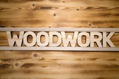 Mot de BOISAGE fait avec les blocs constitutifs sur le conseil en bois image stock