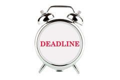 Mot de date-limite sur l'horloge d'alarme photos stock