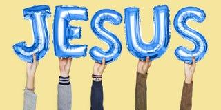 Mot de Jésus de participation de mains dans des lettres de ballon image libre de droits