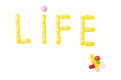Mot de la vie fait avec des pilules Photographie stock libre de droits