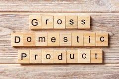 Mot de produit intérieur brut écrit sur le bloc en bois Texte de PIB sur la table, concept photographie stock