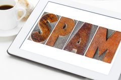 Mot de Spam sur un comprimé numérique Image stock
