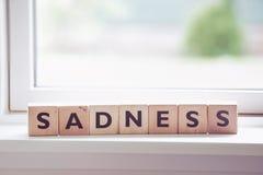 Mot de tristesse fait de bois image libre de droits