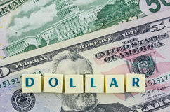 Mot du dollar sur le fond du dollar Concept de finances Photographie stock libre de droits